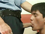 Sex-frenzied cop stretches hunky convict's ass