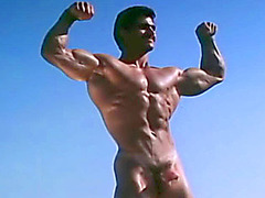 On a sunny day, a sexy man plays with his big cock & cums