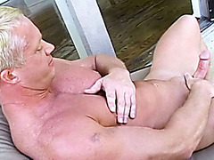 Sweet blond stud caress his big cock straight on his terrace